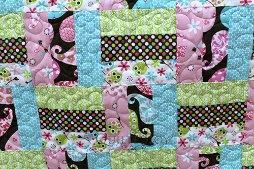 Pamela's Flowers and Hearts quilt after her longarm rental at Quilted Joy