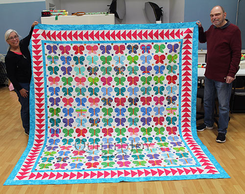 Dennis's butterflies quilt after longarm quilting at Quilted Joy