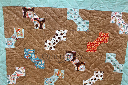 Close up of Linda's dog bones quilt after longarm quilting at Quilted Joy