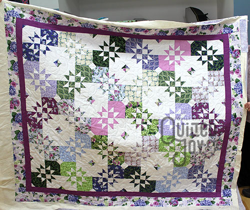 Disappearing Sawtooth Quilt after longarm quilting at Quilted Joy