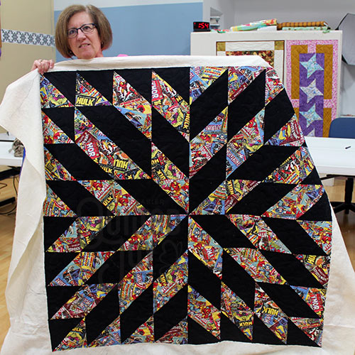 Judy's Marvel Comics Quilt after longarm quilting at Quilted Joy