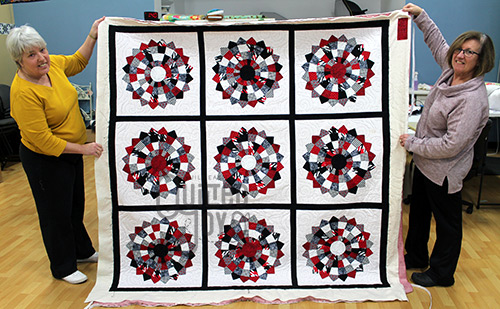 Judy's U of L inspired quilt after longarm quilting at Quilted Joy