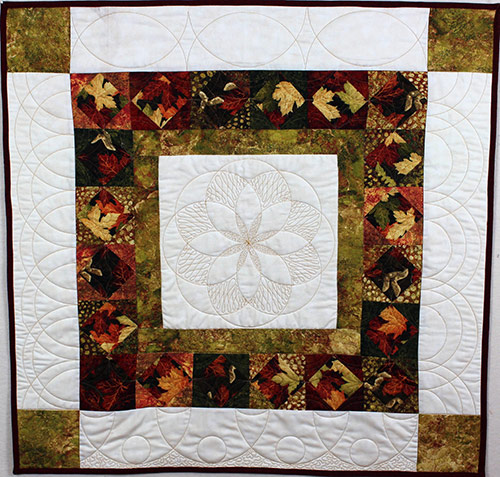 Quilting with Circle Rulers - Quilt by Angela Huffman. Angela Huffman shares tips and ideas for adding circles to your quilting