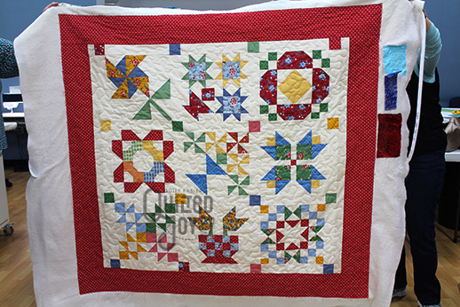 Colleen's Lori Holt Sampler Quilt after quilting it at Quilted Joy