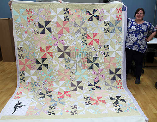 Courtney's pinwheels and ballerina quilt after longarm quilting at Quilted Joy