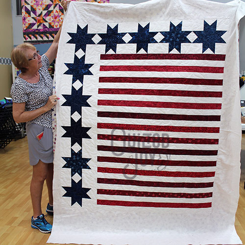 Stars and Stripes Quilt after longarm quilting at Quilted Joy