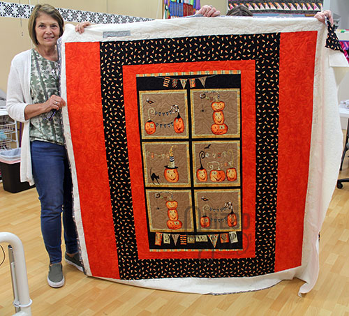 Nancy's Halloween panel quilt after quilting it at Quilted Joy's longarm rental program