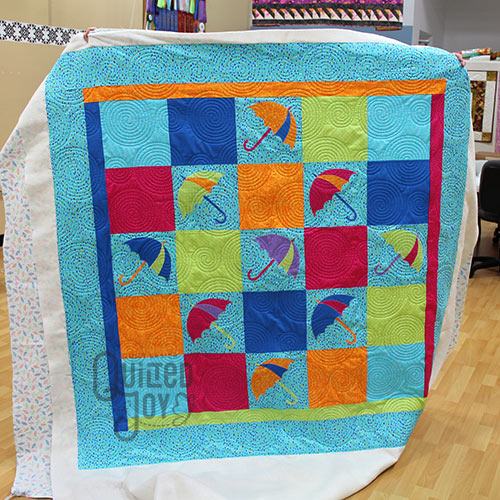 Umbrella quilt, quilted at Quilted Joy