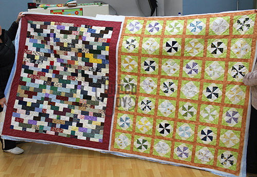 Two quilts quilted by Valerie at Quilted Joy's Longarm Quilting Studio