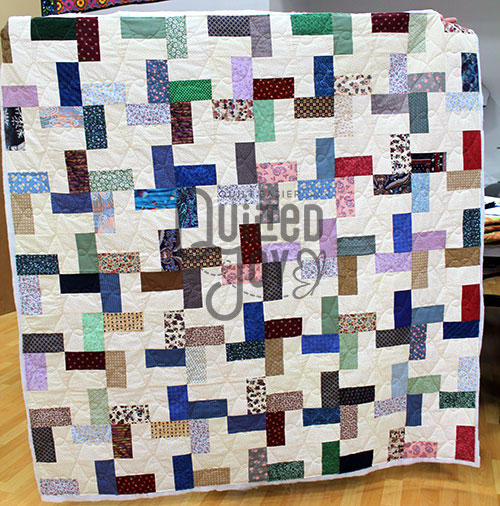 Valerie's simplified pinwheel quilt after longarm quilting at Quilted Joy