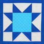 Sawtooth Star quilt block with crosshatching quilting
