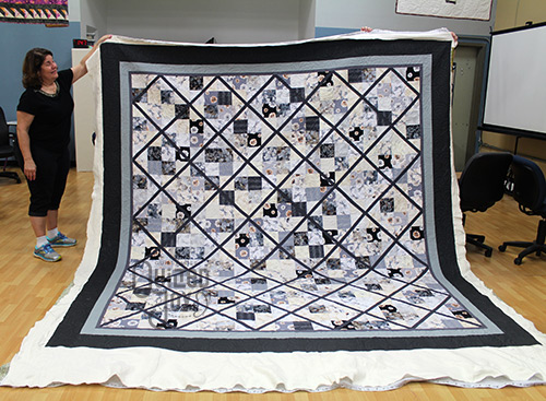 AnnaMaria's Latticework quilt after quilting it on a longarm machine at Quilted Joy