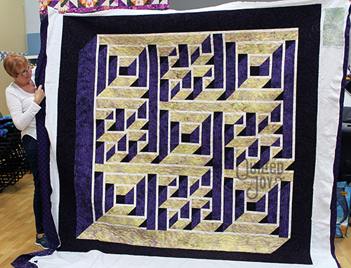 Jennifer quilted this Maze quilt on a longarm machine at Quilted Joy