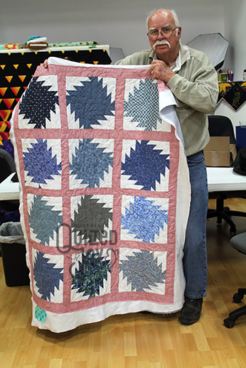 John's Saw Blade Quilt after quilting it on a longarm at Quilted Joy