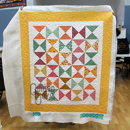 Karla's Hourglass Block Quilt after renting a longarm quilting machine at Quilted Joy