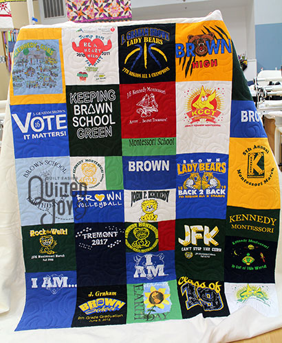 Judy's tshirt quilt after she quilted it on a longarm quilting machine at Quilted Joy