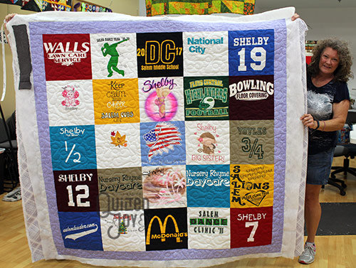 Laura's Tshirt quilt after quilting it on a longarm quilting machine at Quilted Joy