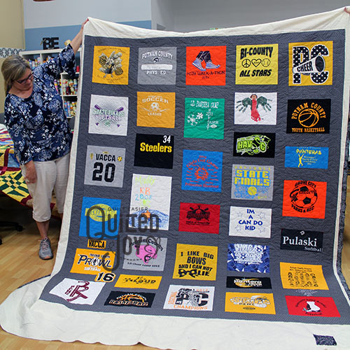 Linda's Tshirt Quilt after she rented a longarm quilting machine at Quilted Joy