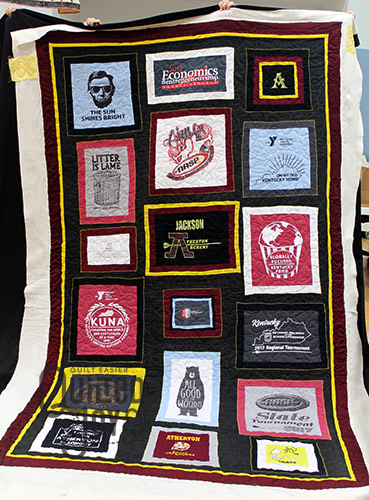 Rebecca's Tshirt quilt after she quilted it on a longarm machine at Quilted Joy