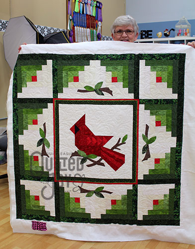 Nancy's Christmas Cardinal Quilt after Longarm Quilting at Quilted Joy
