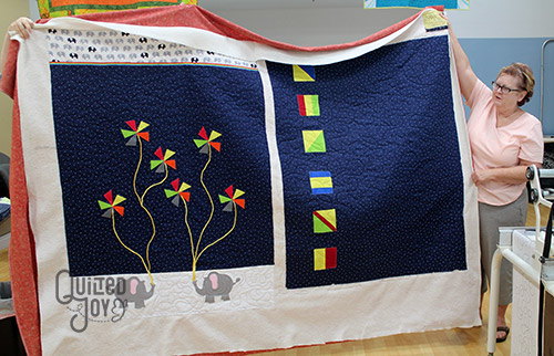 Peggy's Elephant Applique Quilt after quilting it at Quilted Joy on a longarm quilting machine