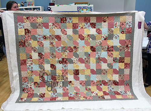 Courtney's slanted star quilt after renting a longarm quilting machine at Quilted Joy