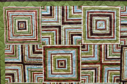 Carol's quartered stripe quilt after longarm quilting it at Quilted Joy