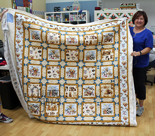 Falicia's dog quilt after longarm quilting it at Quilted Joy