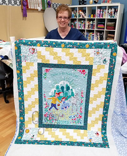 Nancy's Wizard of Oz quilt after longarm quilting it at Quilted Joy