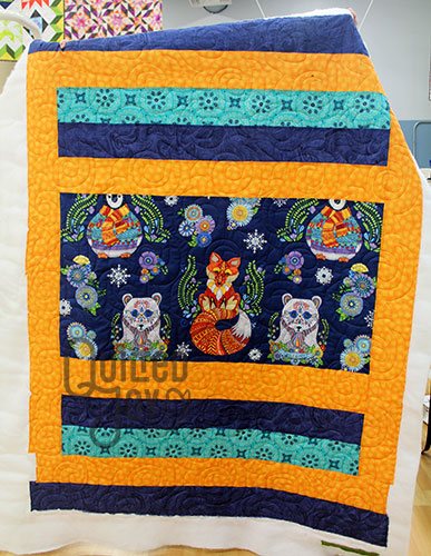 Peggy's arctic wonderland quilt after quilting it at Quilted Joy