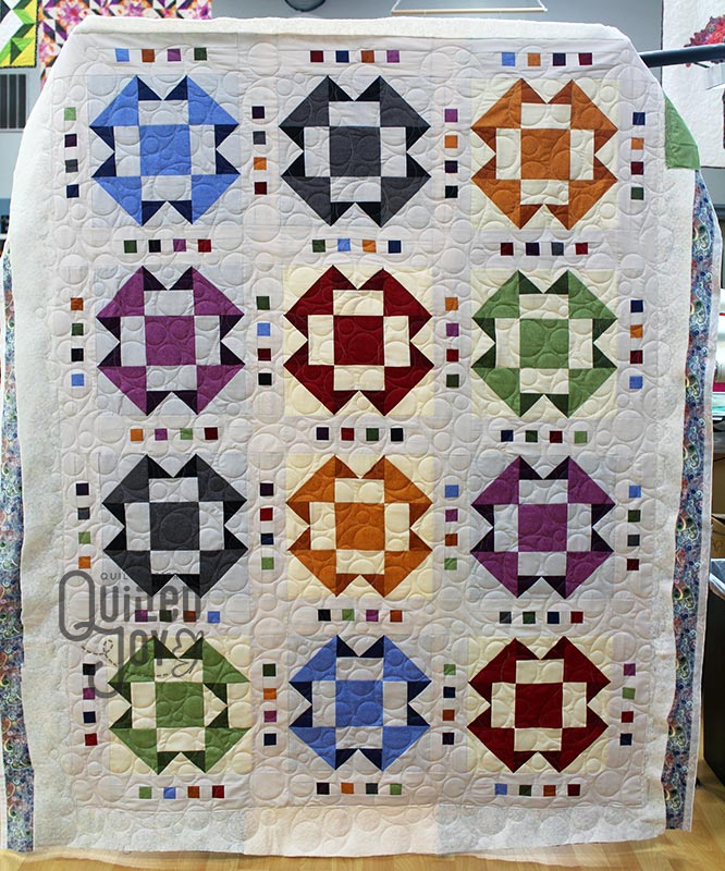 Bill's Folded Corners Quilt after renting a longarm at Quilted Joy