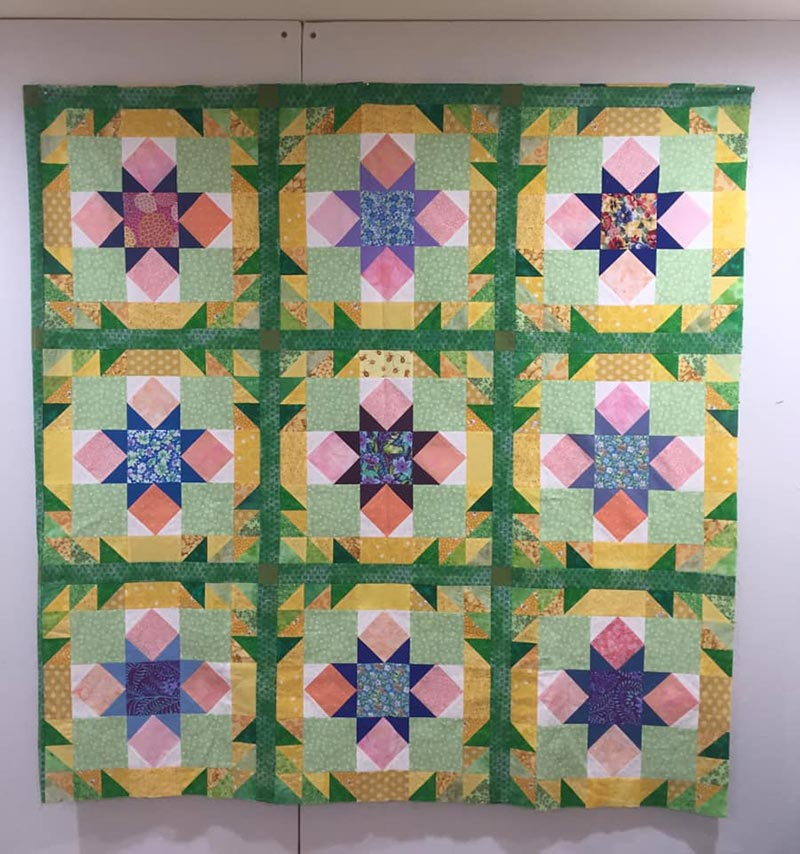 Hometown Blooms Quilt, pattern designed by Angela Huffman of Quilted Joy.