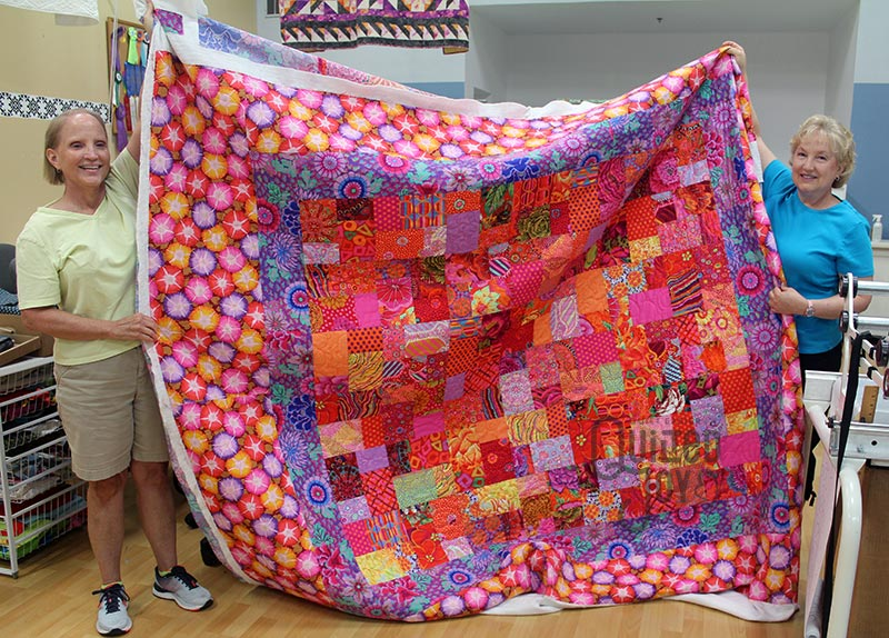 Kathy's colorful Kaffe Fassett inspired quilt