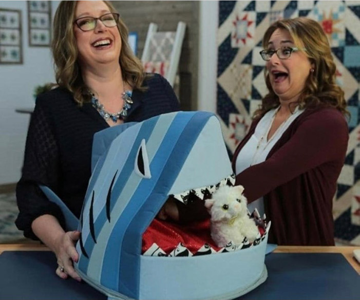 Angela Huffman and Sara Gallegos have fun with the Shark Bait Cat Bed on the set of Love of Quilting TV show