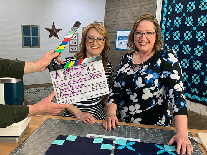 Angela Huffman and Sara Gallegos on the set of Love of Quilting TV with Angela's Moonlight Mermaid Quilt in the background