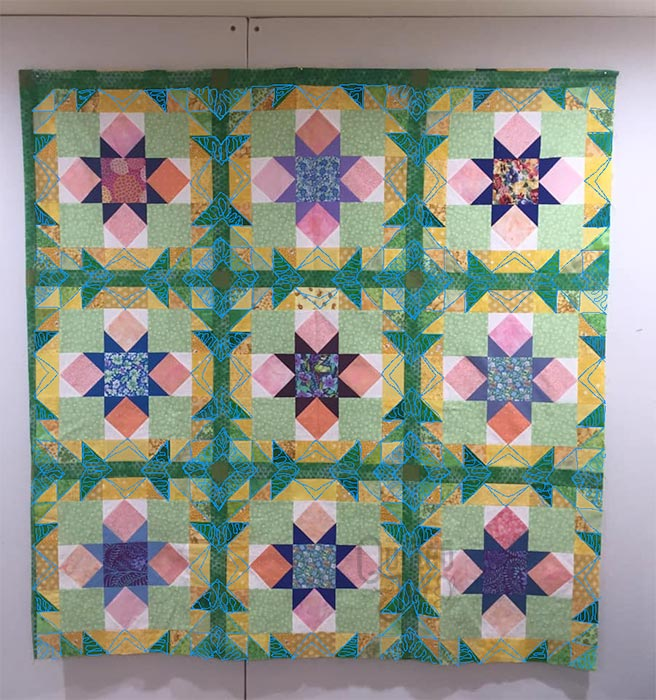 Hometown Blooms Quilt with quilting plan ideas by Angela Huffman
