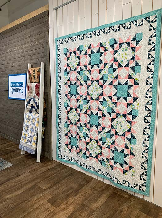 Songbird Stars quilt by Angela Huffman on the set of Love of Quilting TV Show