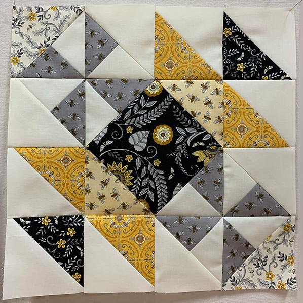image of a quilt block from the All the Buzz quilt
