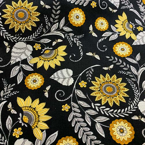 image of printed fabric with gold flowers, white leaves, and black background