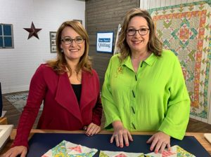 image of Angela Huffman and Sara Gallegos on the Fons & Porter Love of Quilting set with Summer Saturday Quilt behind them
