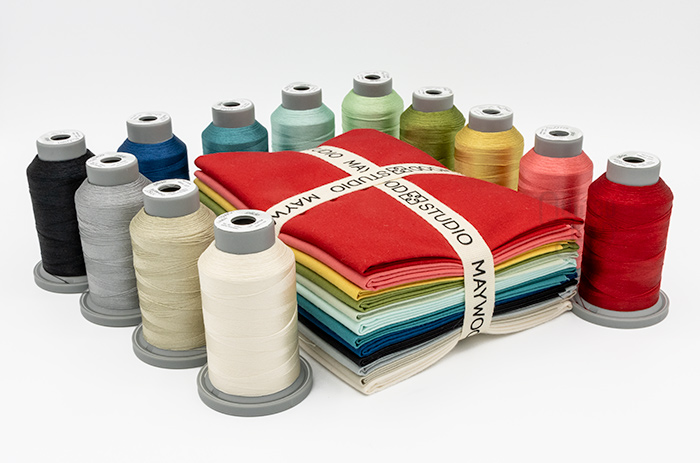 Silky Solids Fat Quarter bundle and Co-ordinating Silky Solids Glide Thread Pack Available at Quilted Joy
