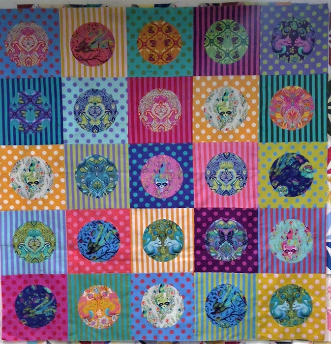 image of a colorful quilt using Tula Pink All Stars and polka dot fabrics