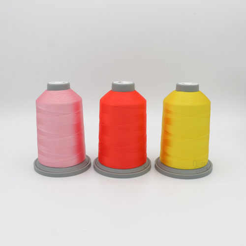 Image of Glide Thread in the Primrose Pixie Thread pack. Three cones of Glide thread in Pinks and yellow.