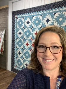 image of Angela Huffman with Blue Ridge Love Quilt in the background
