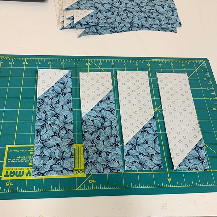 image of fabric strips on a cutting mat
