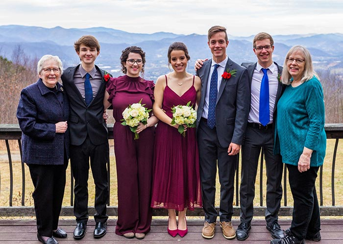 image of a family with mountaintop views in the background