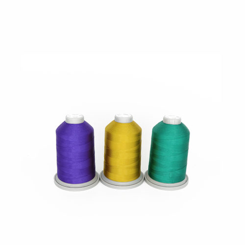 Image of Glide Thread in the Dark Fairy Thread pack. Three cones of Glide thread in purple, gold and green